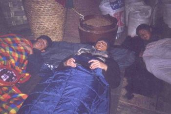 Dinesh Wagle and others sleeping in chepuwa village. Just below our legs is the main entrance of the house. The entrance gate also serves as the excretion point (toilet, yes) for the family members. Pigs are kept just below the E point for obvious reason.