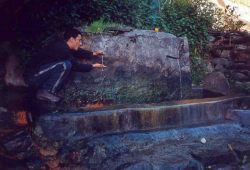 touching hot spring water