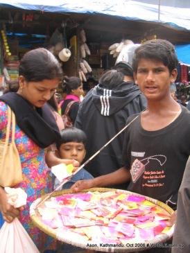 boy selling color powder om ason