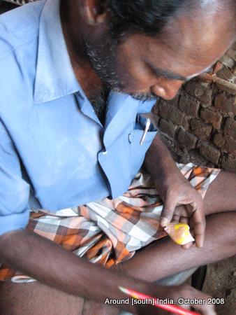 a man writing on sea shell