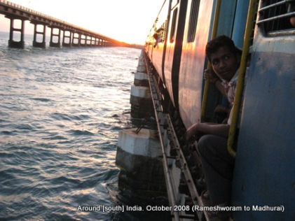 a train and a bridge over sea near rameswaram