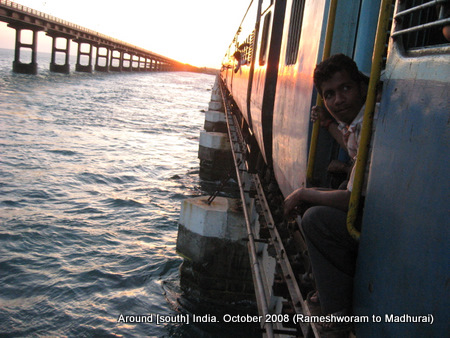 a train and a bridge over sea near rameswaram