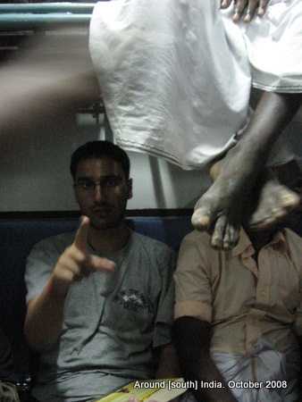 dangling legs of passengers in a train to madhurai from kanyakumari
