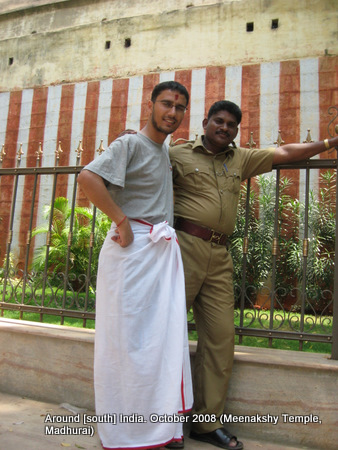 dhoti wearing dinesh wagle and a policeman who was on duty at the meenaxi temple madhurai