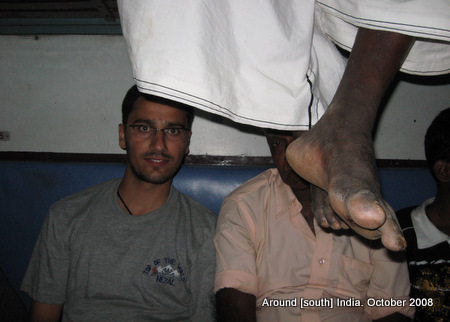 dinesh wagle and legs of passengers in a train to madhurai from kanyakumari