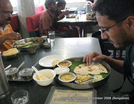 dinesh wagle eats food served on banana leaf and plate in a restaurant in bangalore