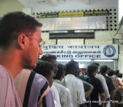 dinesh wagle standing in a line in the train station in madhurai to get a ticket to rameswaram