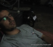 dinesh wagle struggles to take a nap on the street just outside a hotel in rameswaram