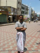 dinesh wagle wearing part of a dhoti in front of madhurai meenaxi temple