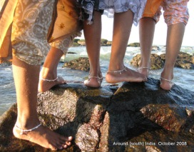 feet of women in kanyakumari beach
