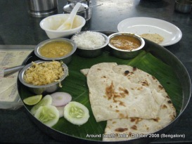 food served on banana leaf and a plate in a restaurant in bangalore