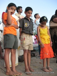 kids waiting to see the sun rise at a beach in Kanyakumari