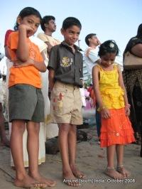 kids waiting to see the sun rise at a beach in Kanyakumari