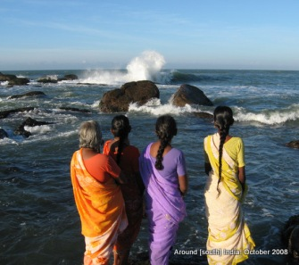 women watching sea waves in kanyakumari