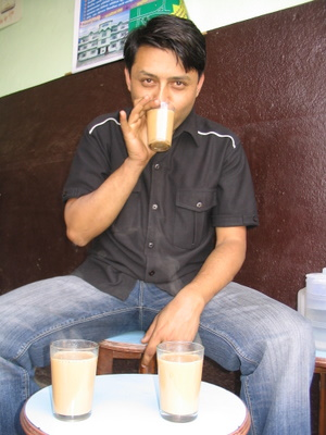 deepak adhikari sipping tea