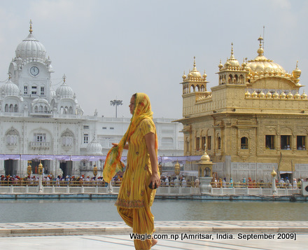 a kid runs after taking dip in the sacred pond at the golden temple, amritsar