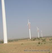 camel safari in jaisalmer india windmills