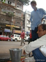 men fill up their buckets in MG Marg, Kolkata