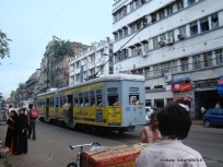 A tram runs on busy MG Road, Kolkata