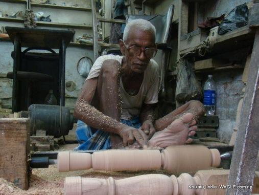 Man at work on MG Road, Kolkata