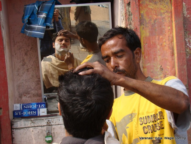 clean shave at a varanasi ghat