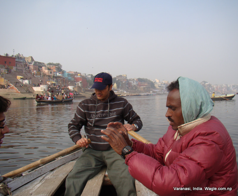 The boatman let us row as he chewed tobaco and took rest