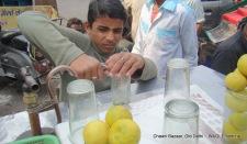chawri bazaar old delhi. a boy prepares lemonnade