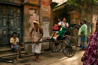 runner-pulled rickshaws of kolkata, india