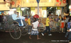 runner-pulled rickshaw of kolkata, india