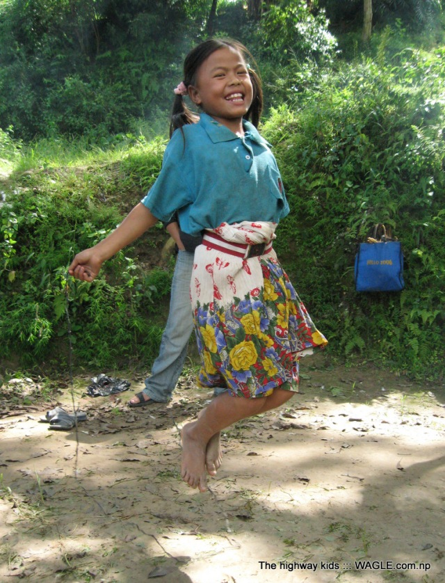 highway kids of nepal. playing skipping