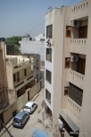 man at work: A labourer paints a house in New Delhi's Jangpura Extension neighbourhood