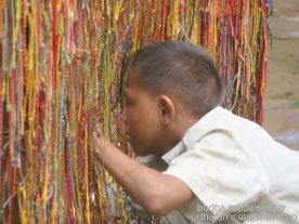 Prayer threads and a kid in Budha Subba
