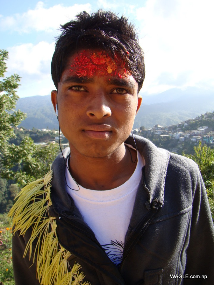 boy dadeldhura nepal on the day of dashain tika