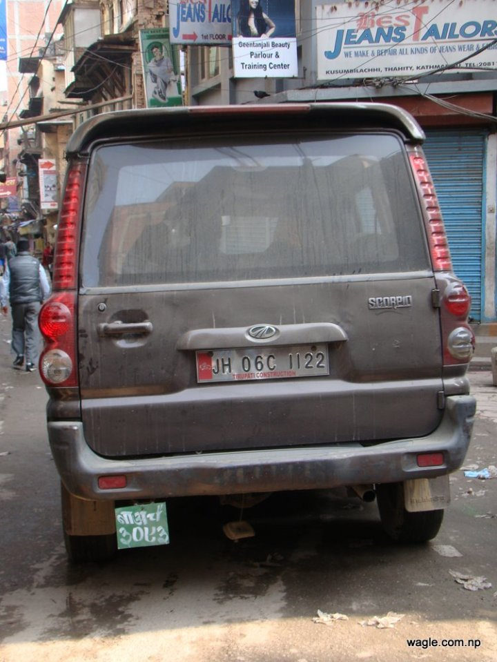 a car with indian and nepali license plates in kathmandu