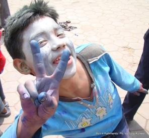 A lad celebrating Holi poses for camera in Minbhawan, Kathmandu