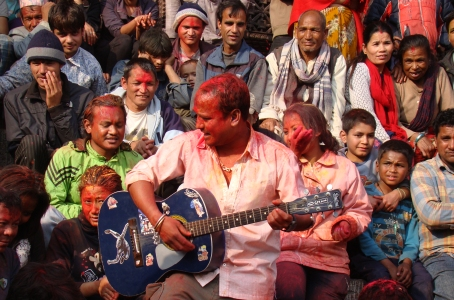 A group of locals try to have some fun in Basantapur Darbar Square in Kathmandu while celebrating Holi