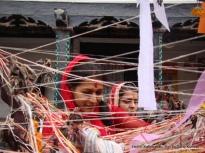 A Marwari devotee circumventing the Cheer in Basantapur, Kathmandu as part of Holi celebrations by her community