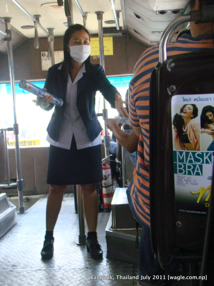 bangkok lady collector in a bus