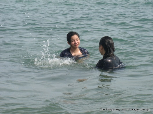 the philippines: a mom and her daughter in the sea