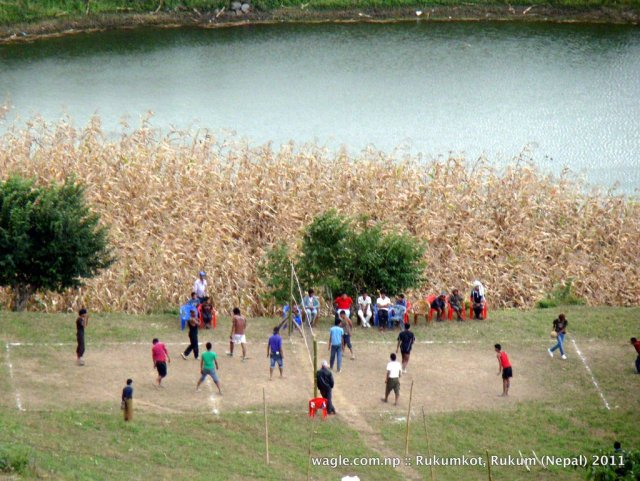 1-playing volleyball by the pond in rukumkot
