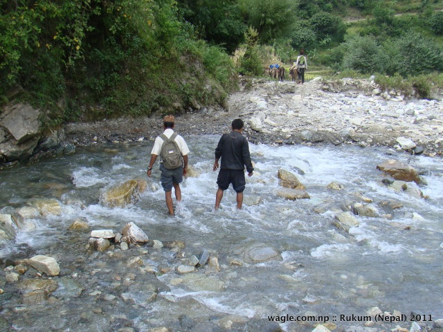 men crossing a river