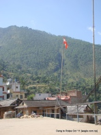 two nepali congress party flags in Libang bazaar, the administrative center of the Maoist heartland, symbolized the change and transition to peace
