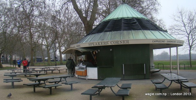 A shop near the Speakers' Corner in Hyde Park with SC on background. Empty tables await speakers and listeners.