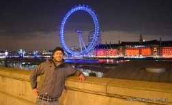Because I am a tourist. And the tourist must smile at the camera with prominent landmark of the place on background.