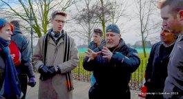 James, right, listens to an elderly stranger. Topic: Euro.