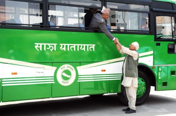 Sajha bus chairman Kanak Mani Dixit, standing, sees off chief secretary Lilamani Poudel who traveled in an inauguratory service.