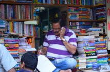 A busy man sorrounded by books