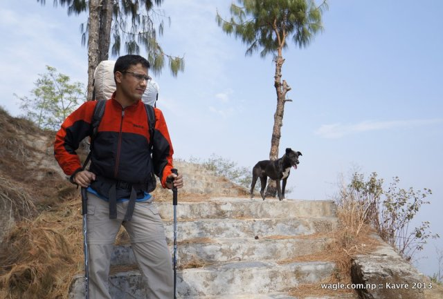 This post describes our four-day-long hiking cum rafting trip. It began obviously from Kathmandu. Peter and I stepped into a bus for Bhaktapur in Koteswor. At Kamal Binayak, we climbed at the top of a bus that took us to Nagarkot. From there began a four-hour-long walk to Sipaghat, a small village near Indrawati river. A dog followed us for long in the trail. We also walked with a talkative woman for a while. And a man, who Peter thought was drunk, accompanied us briefly in the trail.