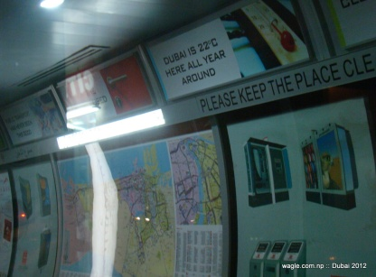"""Inside the bus stand the notice says """"Dubai is 22* C here all year around""""."""