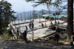 Nepali migrant workers constructing a building